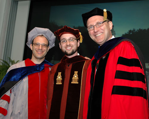 Donald Porter (Center) celebrates his graduation from UTCS with Associate Professor Emmett Witchel (Left) and Professor Lorenzo Alvisi (Right) at the 2011 UTCS Ph.D. Hooding Ceremony.