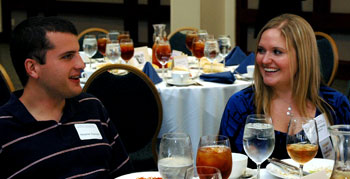 Mary Ann Bailey of Facebook, an FoCS member, visits with UTCS student and scholarship recipient Alexander Espinosa at the 2009 Scholarship Lunch.