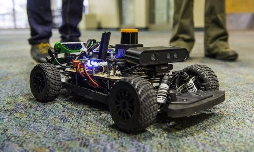 The Biswas lab demos robotic cars at campus events like the college donor brunch and Explore UT.