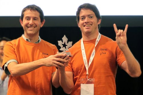 Peter Stone (left) and Patrick MacAlpine (right) accept the 1st place trophy for the 3D Simulation League at RoboCup 2018, held in Montreal, Canada.