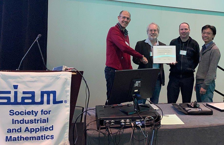Robert van de Geijn, Lee Killough, and Tze Meng Low accepting the award at PP20 in Seattle, Washington