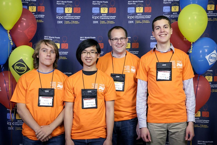 UT Competitive Programming team: Brian Richer, Supawit Chockchowwat, faculty coach Etienne Vouga, and Alex Meed.