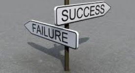 crossroads sign with failure in one direction and success in the other