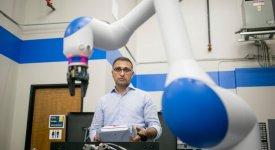 Dr. Chetan Kapoor with a dual-arm, SDA10F robot
