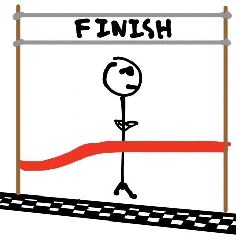 A man stands in front of the finish line and refuses to cross.