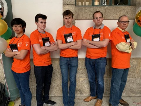 ICPC competitors from UT stand together as a group at the competition
