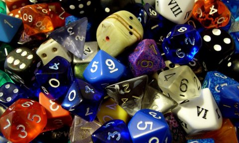 Pile of different colored and shaped dice.