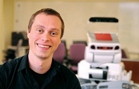 Assistant Professor Scott Niekum with a robot in the PeARL Lab at UT Computer Science